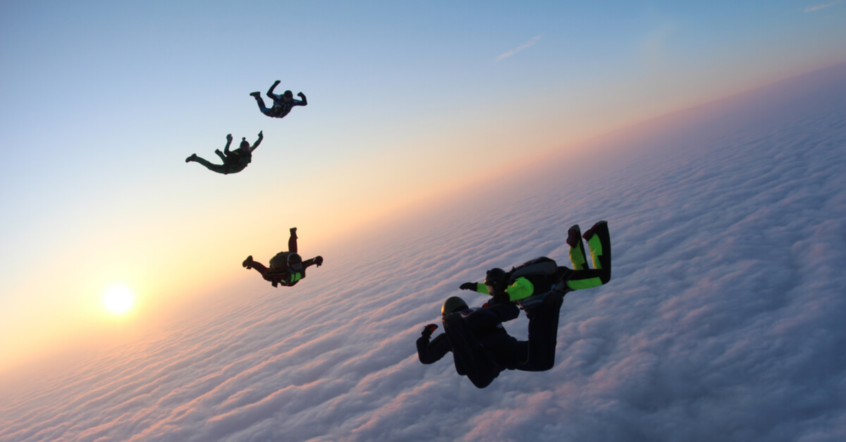 Group of skydivers in the clouds