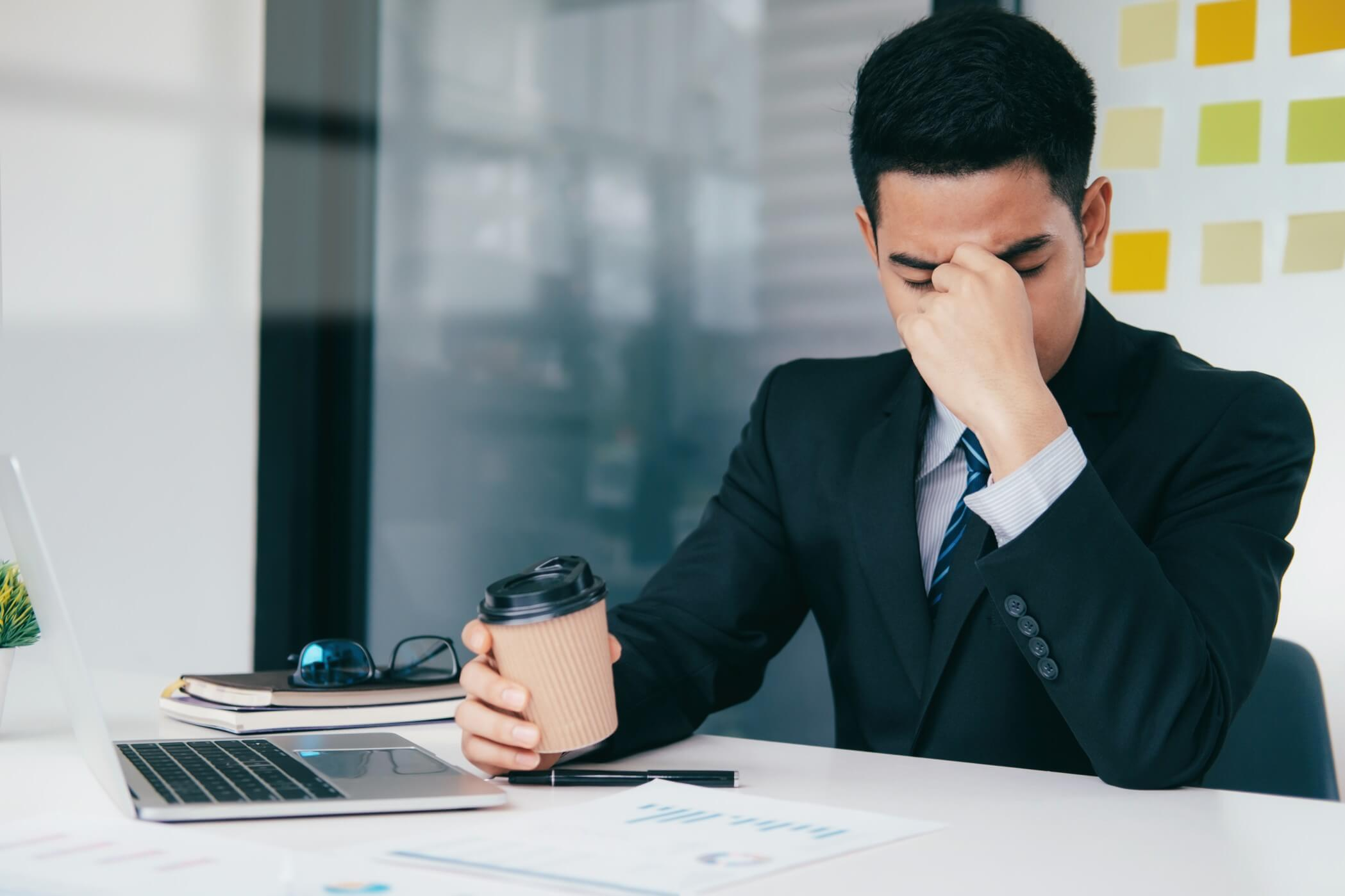 dignity at work stressed man in suit