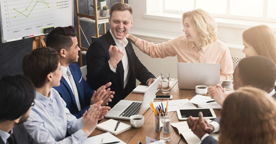Group celebrates good work in an office