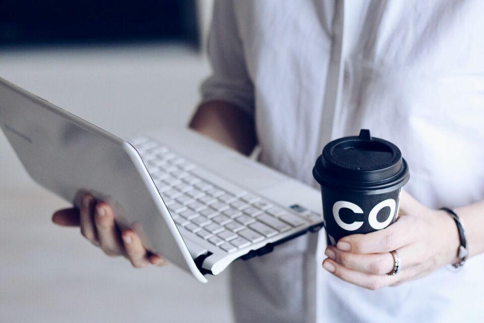 what does it mean to have perks man holding coffee and laptop