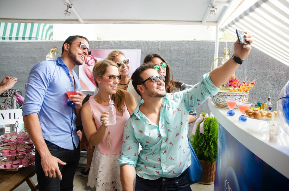 perks meaning employees at a summer party taking a selfie