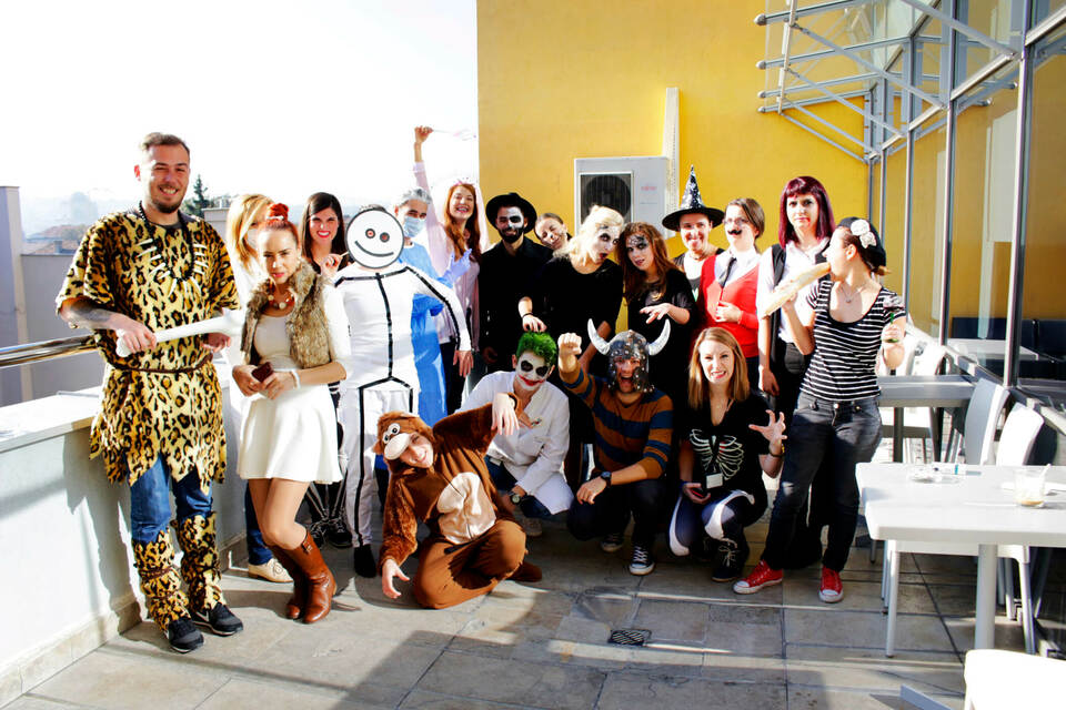 perks meaning employees dressed up at a halloween party