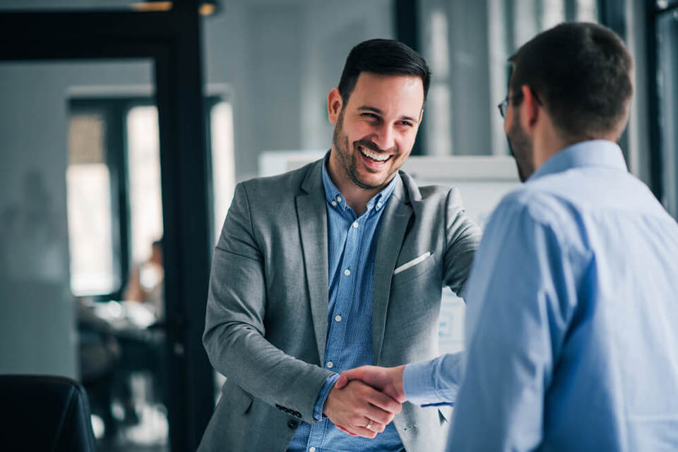 Employee shaking hands with manager as they are leaving