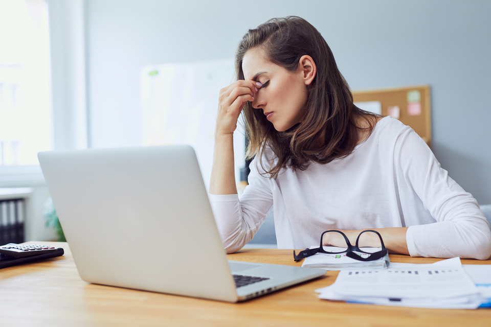 woman at work looking stressed